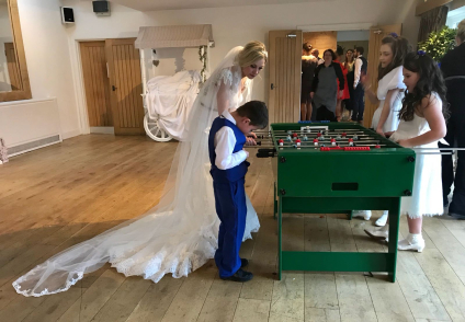 traditional table football game and bride